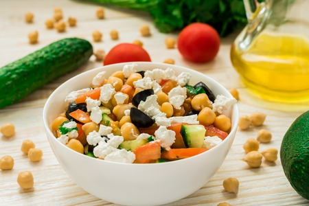 Vegetarian chickpea salad with olives, feta, tomatoes, onion, garlic and a light lemon dressing