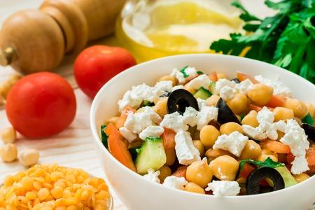 Vegetarian healthy chickpea greek salad and red lentil Standard-Bild