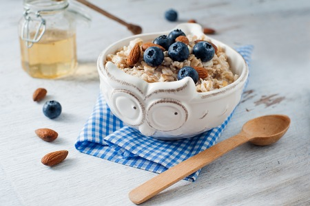 Light oatmeal breakfast with almond and blueberry