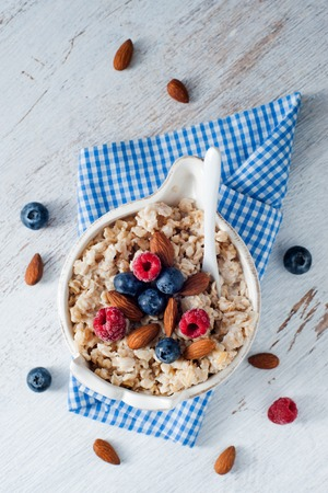 A cereal breakfast with berries and nuts