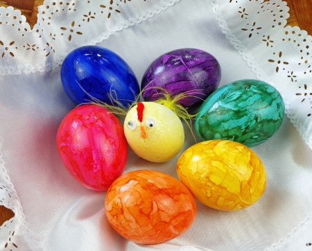 interleaved: Funny crazy little chick and easter eggs