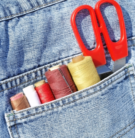 Closeup to jeans pocket with tailor tools photo
