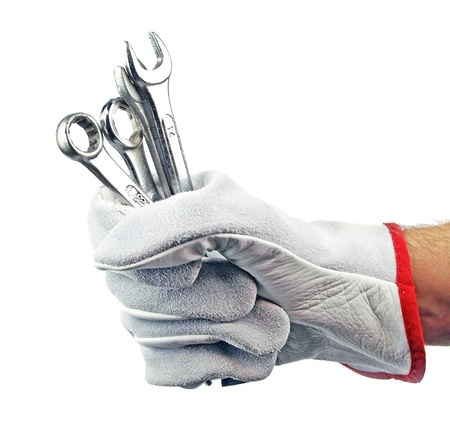 Wrench in hand with protection glove photo