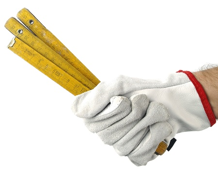 yard stick: A hand with a yard stick  Stock Photo