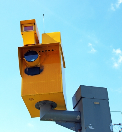 Speed camera and Traffic Light on Green against a Blue Sky