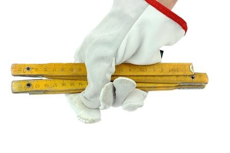 yard stick: A hand with a yard stick
