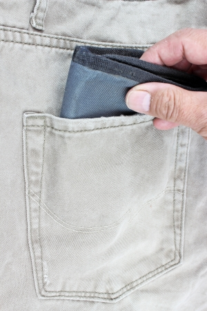 inattention: wallet in jeans pocket Stock Photo