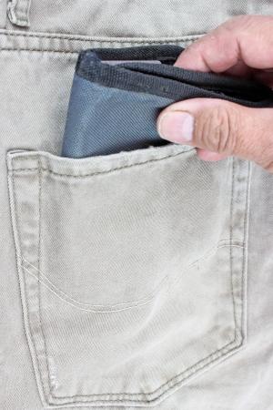 unconcerned: wallet in jeans pocket Stock Photo