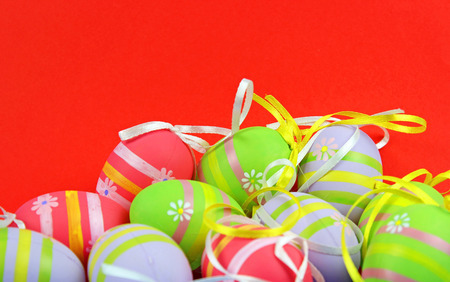 Easter eggs on red background  photo
