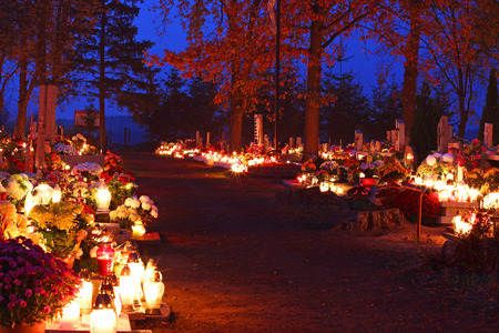 Cemetary decorated with candles for All Saints Day at night Stock Photo - 33417467