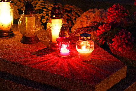 all saints  day: Cemetary decorated with candles for All Saints Day at night Stock Photo
