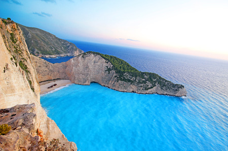 greece: Navagio Beach Shipwreck beach on Zakynthos island at sunset, Greece Stock Photo