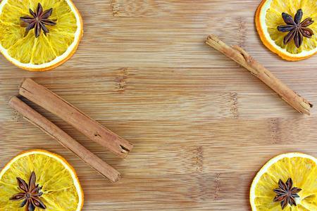 orange peel clove: sliced and sliced lemons on wooden background .Frame Stock Photo