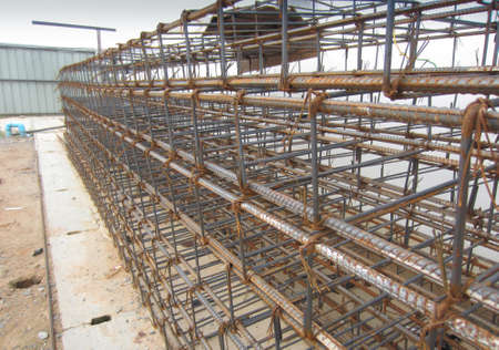 Steel framework for casting weight bearing beams in dormitory buildings