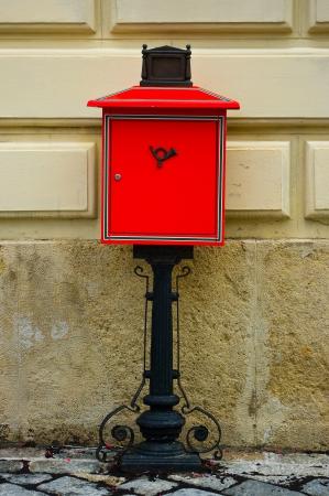 addressee: Red mailbox on the corner