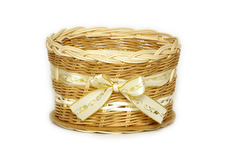brushwood: A wicker basket with bow textile home decoration Stock Photo