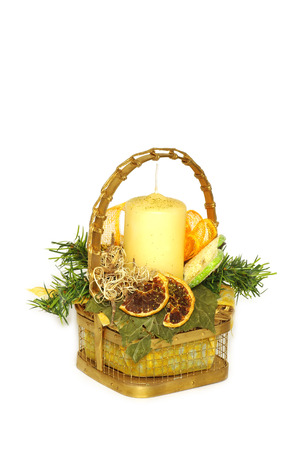 lumen: A wicker basket and candle home decoration