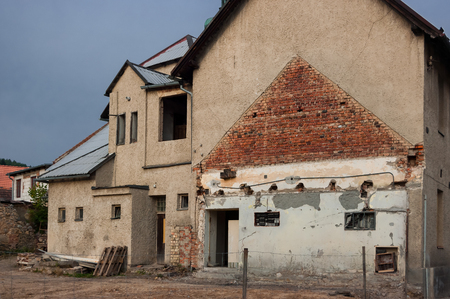 The old dilapidated house designed for demolition. Stock Photo