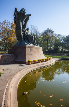 Famous statue of Frederic Chopin, monument of great polish composer, Autumn in Lazienki Park, Warsaw, Poland