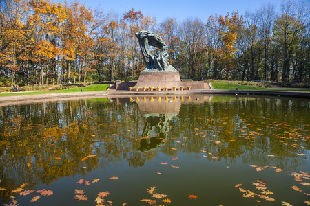 Famous statue of Frederic Chopin, monument of great polish composer, Autumn in Lazienki Park, Warsaw, Poland photo