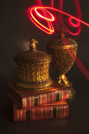 Aladdins Wish is a representation of that moment in which Aladdins genie is granting his wish and the red lightpainting reflects that magic over the vases and books with reddish subjects and black background