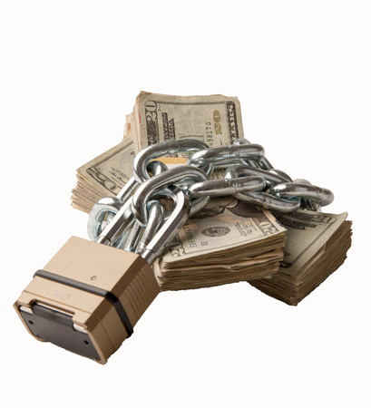 Chained money is a metaphor for monies that are tied up and not easily availabile.  Commercial use.