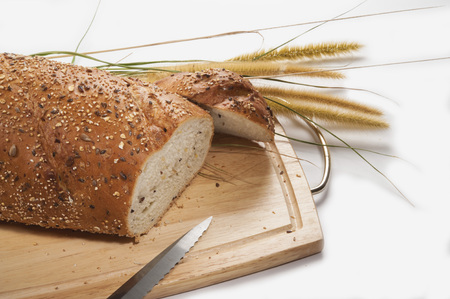 Breading bread is a delicious way to start your day in breakfast, all the grains and nourishment it contains will give you a kick start to your morning. Stock Photo