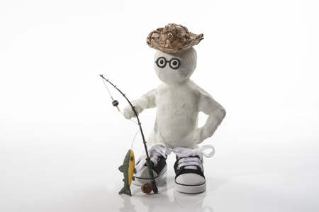 Fishing gear shows clay man caught a fish.  Commercial use