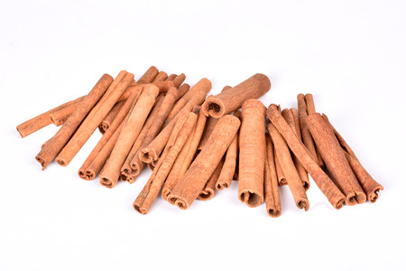 Isolated cinnamon on white background.Cinnamon sticks.Spices for coffee. Banco de Imagens