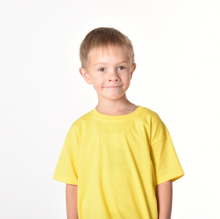 A boy on a white background. A good baby. A fine mood. A boy's shirt in a T-shirt. Category People