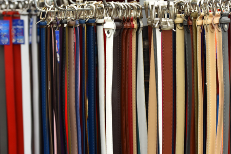 Sale of leather belts for trousers. Tighten the belt.