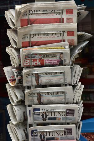 Switzerland, Zurich. 30 April 2018. Sale of newspapers in Zurich. Redactioneel