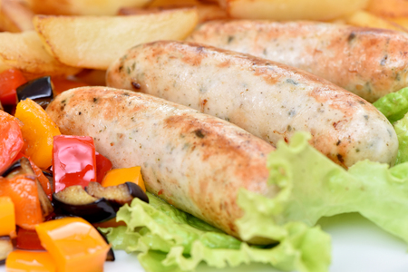 Bavarian sausages. German cuisine. A dish of chicken meat.