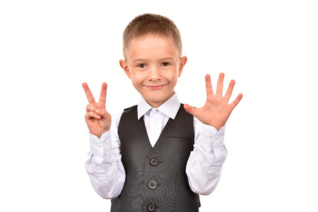 The boy is seven years old. The boy on a white background.