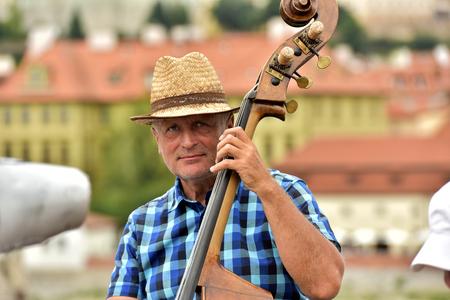 Czech Republic Prague June 26, 2017. A street musician playing the double bass. Éditoriale