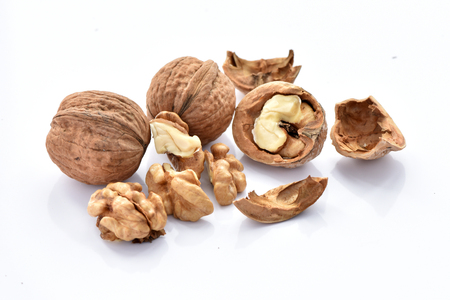 Walnuts on a white background. Imagens
