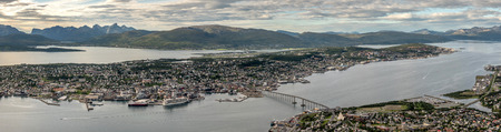 Panoramic view of Tromso with Kvaloya mountains in the background and sea surrounding the town. Troms, Norway 写真素材