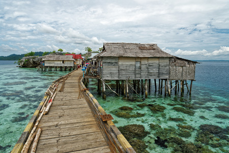 View of traditional bajo village with bridge and wooden houses on the Togean islands in Central Sulawesi, Indonesia