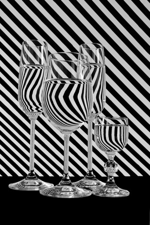 water black: Water refraction in glass of water, black and white stripes Stock Photo