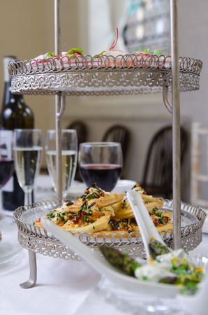 venue: Canapes table set up at wedding venue Stock Photo