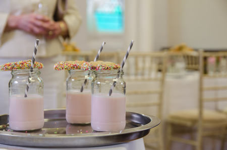 milk shake: Fancy milk shake with cookie and straw at venue Stock Photo