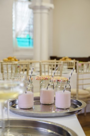 venue: Fancy milk shake with cookie and straw at venue Stock Photo