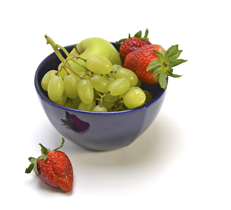 watery: Fruit - grapes, strawberries and apple on a white background