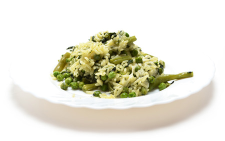 ejotes: Rice, peas, spinach, green beans and cheese on white plate