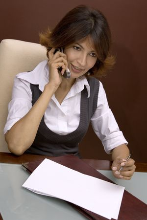 business woman talking on the phone photo