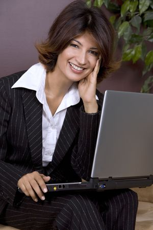 formal business woman with laptop