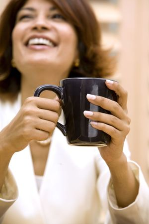 beautiful brunette holding black cup of coffee Stock Photo