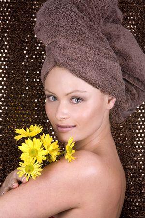 beautiful blond woman wearing brown towel and natural makeup