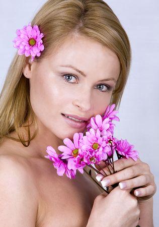 beautiful blond model wearing purple flower in her hair photo