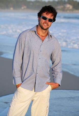 white pants: man wearing shirt and white pants on the beach during vacation Stock Photo